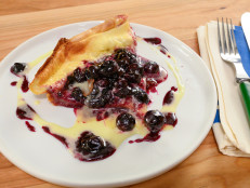 Dutch Baby with Lemon Curd and Blueberry Syrup