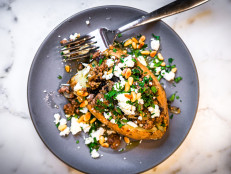 Roasted Sweet Potatoes Topped with Spiced Ground Beef and Pine Nuts