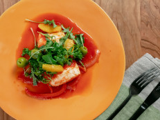 Tomato-Poached Halibut with Arugula, Olive and Orange Salad