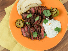 Hanger Steak Tacos with Cilantro-Lime Crema and Charred Limes