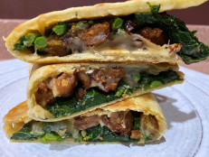 Italian Flatbread Sandwich (Piadina) with Sausage and Broccoli Rabe