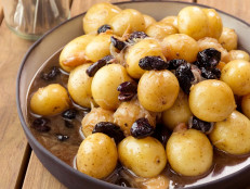 Duck Fat-Roasted New Potatoes, Moroccan Black Olives, Thyme, Caramelized Shallots, and Garlic Cloves